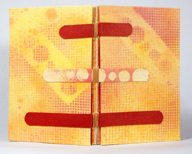 Warm Hues Sewn-Over-Tapes Book Spine. Tapes are leather and painted canvas.